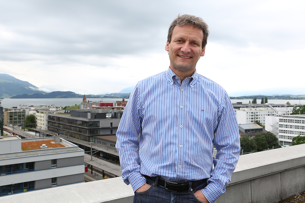 Vitus Ammann, CMO of Monetas, on the top of the buliding where the company has its office in Zug, Switzerland