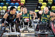 UNITED KINGDOM, London: 2015 World Wheelchair Rugby Challenge. Caption: Australian captain Riley Batt gets flanked by teammates and opposition in a game between Australia and Japan. Rick Findler / Story Picture Agency