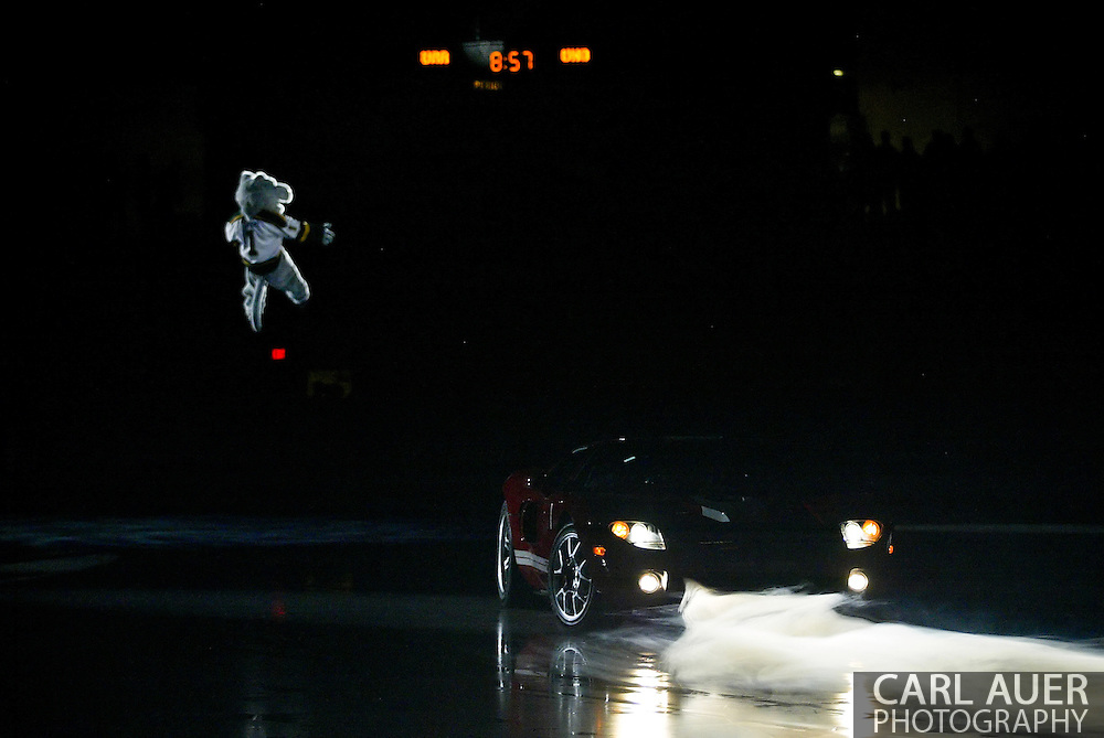10/14/2006 - Anchorage, Alaska: As the Seawolves mascot dropped from the ceiling a 2007 Ford GT went for a little spin on the ice at Sullivan Arena.  One lucky Alaskan was to drive away in this 500 horsepower piece of Detroit Muscle in the most expensive car give-a-way in the history of the State of Alaska