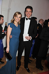 Racing driver SUSIE WOLFF and her husband TOTO WOLFF at the Cord Club's 'Wings For Life' Ball held at One Marylebone, London on 28th February 2013.