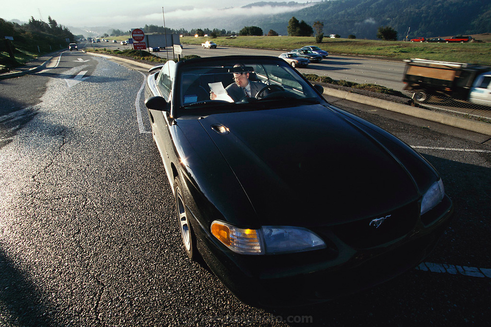 Internet Shop Communications. Internet software; Stephan Shambach, 27, president and CEO drives to San Francisco from his San Mateo home. He often stops on I280 to make phone calls or read papers in his Mustang convertible. Model Released (1999).