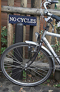Funny shot of bicycle next to sign saying No Cycles, Cambridge, England