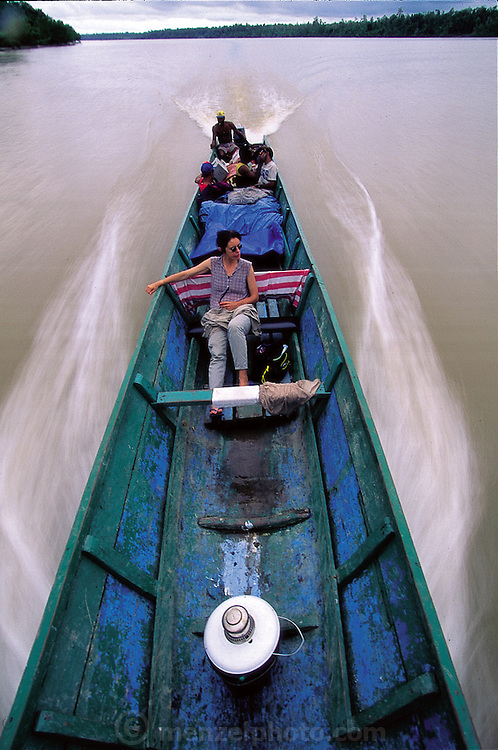Faith D'Aluisio on the ride up the Unir River in a 40-foot longboat headed for Sawa village, Asmat swamp, Irian Jaya, Indonesia.(Man Eating Bugs page 186)