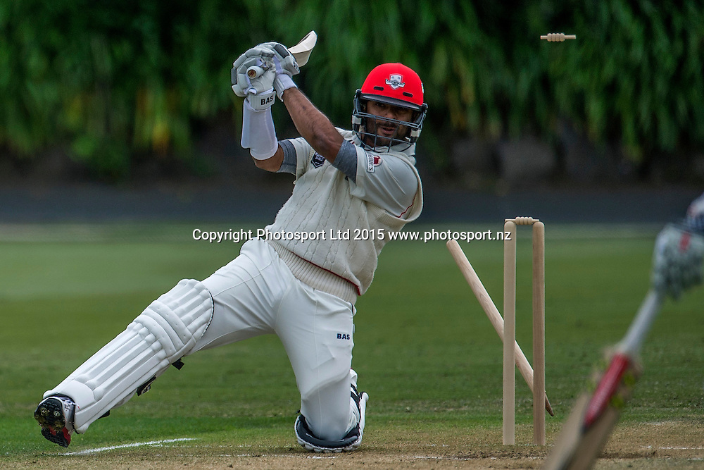 Canterbury's Ronnie Hira bowled by Mitchell McClenaghan during the Auckland Aces v Canterbury Plunket Shield 4 Day Domestic Cricket Game at Eden Park No 2, Auckland. Sunday 18 October 2015. Copyright Photo: Raghavan Venugopal / www.photosport.nz