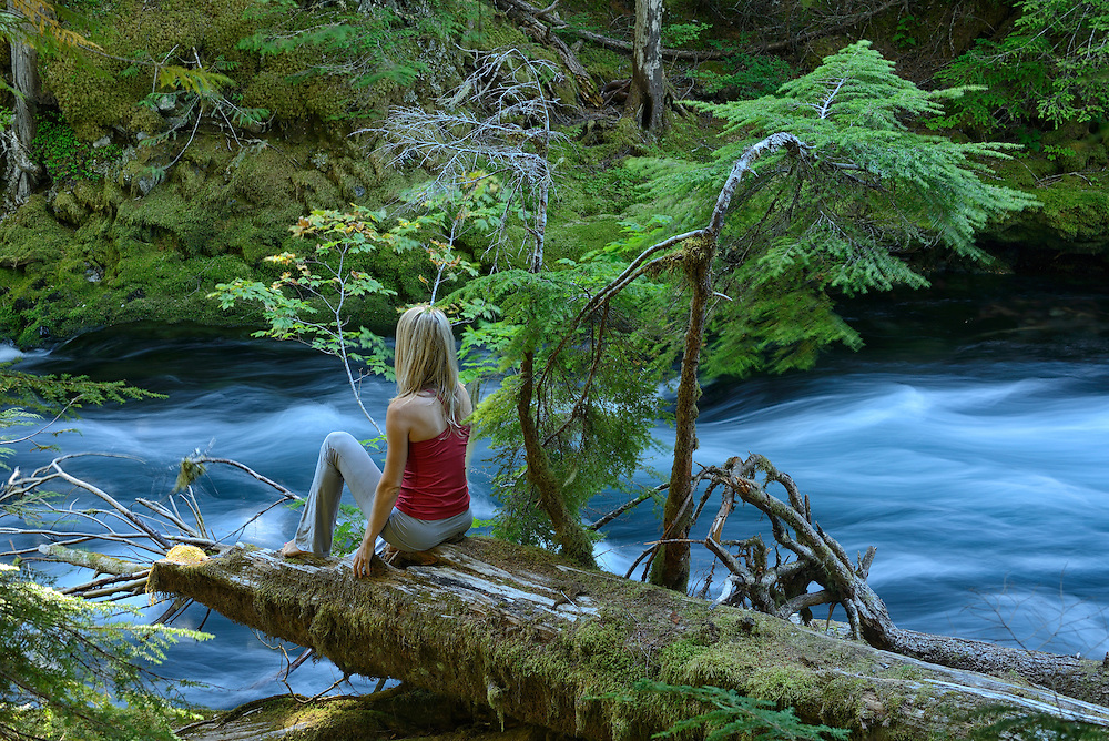 Woman in Yoga position at McKenzie river , near town of Sisters,Central Oregon, USA<br /> Model release 0354