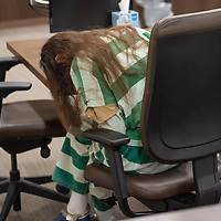Deborah Green, 71, leans over the table after the courtroom cleared during the sentencing trial which was held at the Thirteenth Judicial District Court Wednesday afternoon in Grants.
