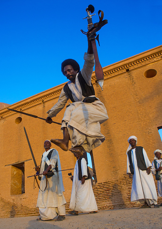 Kassala, Sudan, Beja tribe men dancing in front of the Khatmiyah mosque at the base of the Taka mountains.