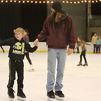 Aaron Barker Jr., 8, skates with his father Aaron Barker Sr. Saturday at the Bancorpsouth Arena