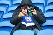 A Cardiff City fan studies the match day programme during the EFL Sky Bet Championship match between Cardiff City and Burton Albion at the Cardiff City Stadium, Cardiff, Wales on 30 March 2018. Picture by John Potts.