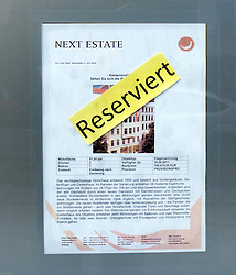 Sign in real estate office advertising house for sale in bohemian district of Prenzlauer Berg in Berlin Germany