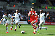 Southampton's Sam Gallagher &copy; breaks past Swansea's Dwight Tiendalli. Barclays Premier league match, Swansea city v Southampton at the Liberty stadium in Swansea, South Wales on Saturday 3rd May 2014.<br /> pic by Andrew Orchard, Andrew Orchard sports photography.
