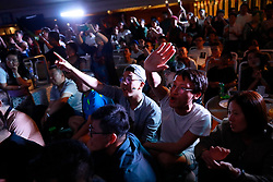 Chinese LGBTs (lesbian, gay, bisexual and transgender) and volunteers of the Parents and Friends of Lesbians and Gays (PFLAG) China organisation wave as they watch a performance during a closing ceremony for the 10th National PFLAG conference held on a cruise in open seas on route back to Shanghai China, 17 June 2017. About 800 members of the Chinese LGBT (lesbian, gay, bisexual and transgender) community and their parents spent four days on a cruise trip organised by Parents and Friends of Lesbians and Gays (PFLAG) China, a grassroots non-government organisation, celebrating the 10th anniversary of the organisation. It aims to promote coexistence among homosexuals and their families.