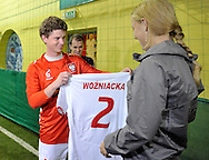 (R) CAROLINE WOZNIACKI ( DANEMARK ) DURING SOCCER TRAINING NATIONAL TEAM OF POLISH JOURNALIST AT BEMOWO FOOTBALL HALL IN WARSAW. WHILE TENNIS GAMES ARE POSTOPONED BY STRONG RAIN DURING FIRST DAY INTERNATIONAL WOMEN TENNIS TOURNAMENT WTA POLSAT WARSAW OPEN AT LEGIA'S COURTS IN WARSAW, POLAND...WARSAW , POLAND , MAY 17, 2010..( PHOTO BY ADAM NURKIEWICZ / MEDIASPORT )..PICTURE ALSO AVAIBLE IN RAW OR TIFF FORMAT ON SPECIAL REQUEST.