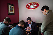 Republican U.S. presidential candidate Rick Santorum prays with members of his campaign staff during lunch between stops in Le Mars, Iowa on October 30, 2015.