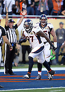 Denver Broncos defensive end Malik Jackson (97) runs with the ball as he celebrates after recovering a fumble by Carolina Panthers quarterback Cam Newton (1) on a strip sack by Denver Broncos outside linebacker Von Miller (58) that gives the Broncos a 10-0 lead during the NFL Super Bowl 50 football game against the Carolina Panthers on Sunday, Feb. 7, 2016 in Santa Clara, Calif. The Broncos won the game 24-10. (©Paul Anthony Spinelli)