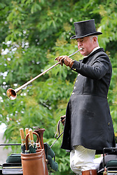 © under license to London News Pictures. WINDSOR, UK  13/05/2011. A footman sounds a horn as The Carriage Marathon makes its way along the Long Walk at Windsor Castle. The Royal Windsor Horse Show in the grounds of Windsor Castle today (13 May 2011). Photo credit should read Stephen Simpson/LNP.
