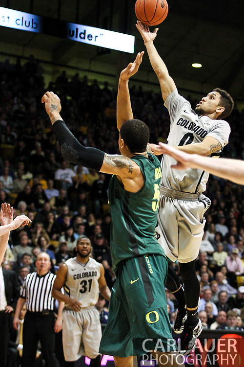 March 3, 2013: Boulder, Colorado - Colorado Buffaloes sophomore guard Askia Booker (0) elevates for a shot in the land in the Colorado Buffaloes game against the University of Oregon Ducks at the Coors Events Center