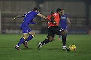 AFC Wimbledon midfielder Tom Beere (16) and Brighton & Hove Albion winger Kazenga LuaLua (30) tussle during the EFL Trophy match between AFC Wimbledon and U23 Brighton and Hove Albion at the Cherry Red Records Stadium, Kingston, England on 6 December 2016. Photo by Stuart Butcher.