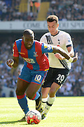 Yannick Bolasie and Dele Alli battle for the ball during the Barclays Premier League match between Tottenham Hotspur and Crystal Palace at White Hart Lane, London, England on 20 September 2015. Photo by Alan Franklin.