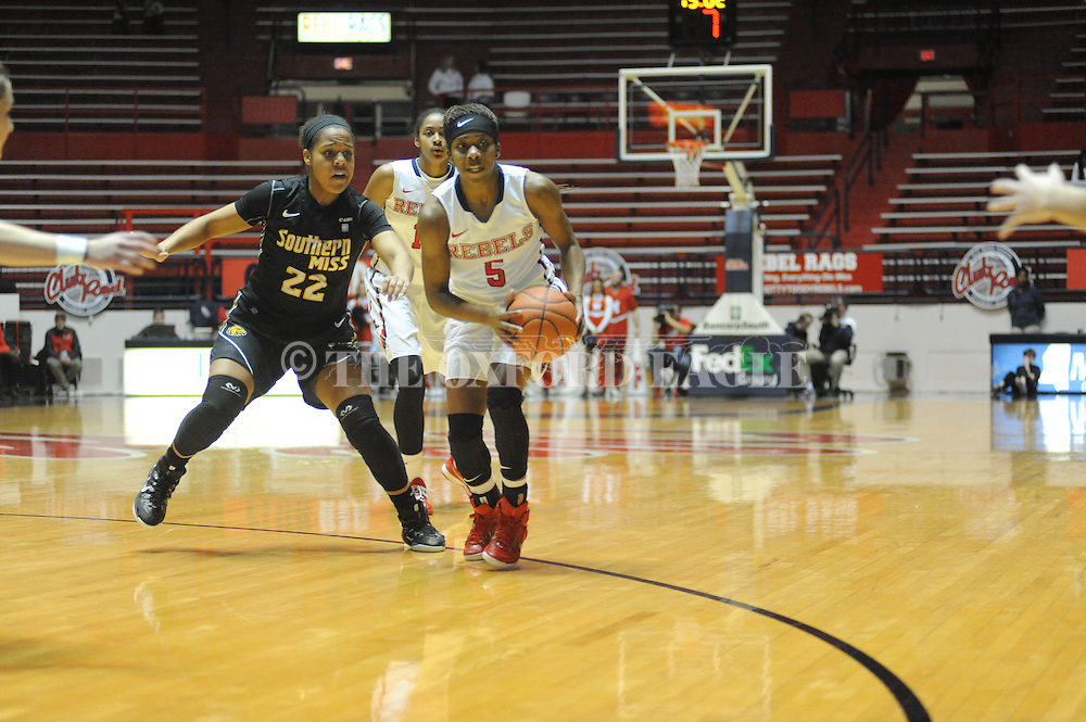 """Ole Miss Lady Rebels guard Erika Sisk (5) vs. Southern Mississippi Lady Golden Eagles guard Megan Brown (22) at the C.M. """"Tad"""" Smith Coliseum in Oxford, Miss. on Thursday, December 18, 2014. (AP Photo/Oxford Eagle, Bruce Newman)"""