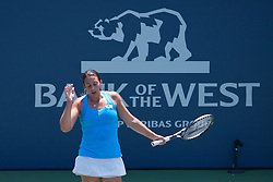 July 31, 2011; Stanford, CA, USA;  Marion Bartoli (FRA) reacts after a point against Serena Williams (USA), not pictured, during the finals of the Bank of the West Classic women's tennis tournament at the Taube Family Tennis Stadium.