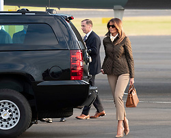 Prestwick Airport, Scotland, UK. 13 July, 2018. President Donald Trump arrives on Air Force One at Prestwick Airport in Ayrshire ahead of a weekend at his golf resort at Trump Turnberry where he is expected to play golf. Pictured. Melania Trump walks to vehicle carrying President to his Trump Turnberry Hotel.