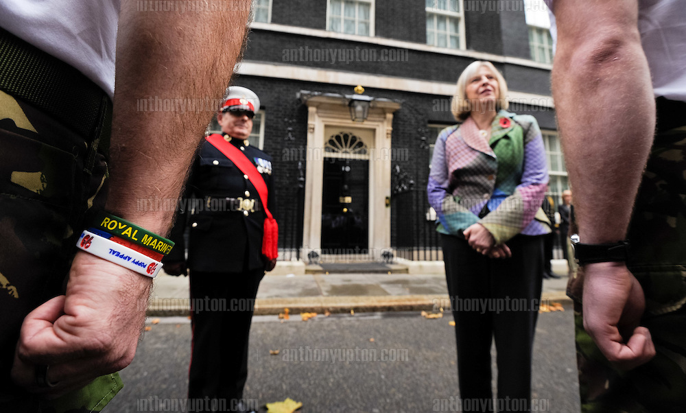 20111112       Copyright image 2011©.Theresa May, the Home Secretary meets members of the Commando 999 team today in Downing Street..Today, November 12th, Remembrance weekend, sees a team of over 100 former Royal Marines Commandos's cover a grueling 26 mile course across central London..Starting from Downing Street, the speedmarch hopes to raise over £1m for The Royal Marines Association by 2014, which is the 350th anniversary of the founding of the Royal Marines, raises funds for war wounded Royal Marines. Commando 999 is made up of former Commandos who are now servingin the UK's emergency services, this includes firefighters, ambulance staff and police officers...For photographic enquiries please call Anthony Upton 07973 830 517 or email info@anthonyupton.com .This image is copyright Anthony Upton 2011©..This image has been supplied by Anthony Upton and must be credited Anthony Upton. The author is asserting his full Moral rights in relation to the publication of this image. All rights reserved. Rights for onward transmission of any image or file is not granted or implied. Changing or deleting Copyright information is illegal as specified in the Copyright, Design and Patents Act 1988. If you are in any way unsure of your right to publish this image please contact Anthony Upton on +44(0)7973 830 517 or email: