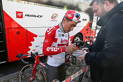 March 10, 2019 - Paris, Ile-de-France, France - A cyclist of the team Lotto Soudal signs an autograph at the start of the 138,5km 1st stage of the 77th Paris-Nice cycling race between Saint-Germain-en-Laye and Saint-Germain-en-Laye in the west suburb of Paris, France, on March 10, 2019. Whether leaders of a team or merely a team-mate, the riders on the Paris-Nice try to excel, either individually or as a team. According to the stage profiles, changes in the general standings or some unexpected circumstance during the race, each rider adapts his objectives to the situation. (Credit Image: © Michel Stoupak/NurPhoto via ZUMA Press)