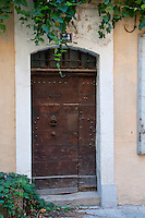 Close-up of a wooden door at number 34 in the historic city of Arles, France.