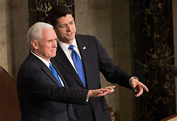 United States Vice President Mike Pence (left) and Speaker of The House of Representatives Paul Ryan (right) acknowledge members of Congress during an address by U.S. President Donald J. Trump to a joint session of Congress on Capitol Hill in Washington, DC, USA, February 28, 2017. Photo by Chris Kleponis/CNP/ABACAPRESS.COM