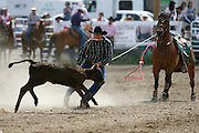 061811-Evergreen, COLORADO-evergreenrodeo-Brian Gillen, of Evergreen, CO, works to tie down a calf during the Evergreen Rodeo Saturday, June 18, 2011 at the El Pinal Rodeo Grounds..Photo By Matthew Jonas/Evergreen Newspapers/Photo Editor