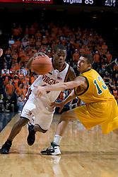 Virginia Cavaliers G Sean Singletary (44) dribbles past Vermont Catamounts G Mike Trimboli (13).  The Virginia Cavaliers men's basketball team defeated the Vermont Catamounts 90-72 at the John Paul Jones Arena in Charlottesville, VA on November 11, 2007.