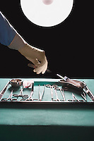Surgeons hand reaching for medical equipment in operating theatre