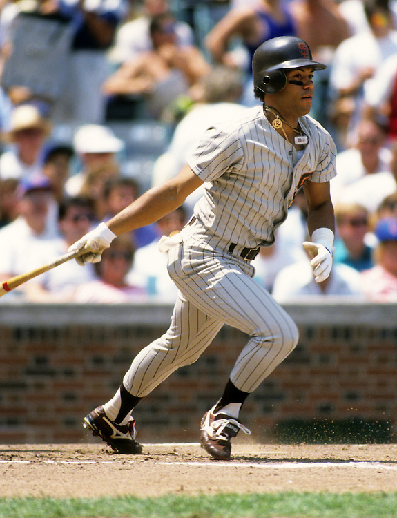 CHICAGO - 1990:  Roberto Alomar of the San Diego Padres bats against the Chicago Cubs during an MLB game at Wrigley Field in Chicago, Illinois.  Alomar played for the Padres from 1988-1990.  (Photo by Ron Vesely)