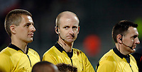 Photo: Daniel Hambury.<br />Lyon v PSV Eindhoven. UEFA Champions League. 08/03/2006.<br />English referee MIke Riley and his two assistants David Babski (L) and Peter Kirk wear microphone headsets as they take charge of the match.