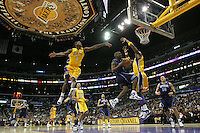13 February 2006: Guard Milt Palacio of the Utah Jazz drives to the basket past (1) Smush Parker of the Los Angeles Lakers and into (7) Lamar Odom of the Los Angeles Lakers during the 4th period of the Lakers 94-88 victory over the Jazz at the STAPLES Center in Los Angeles, CA.