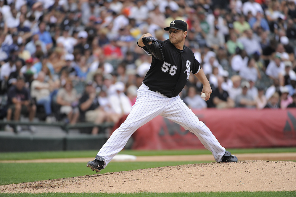 CHICAGO - JULY 23:  Mark Buehrle #56 of the Chicago White Sox pitches against the Tampa Bay Rays on June 23, 2009 at U.S. Cellular Field in Chicago, Illinois.  Buehrle pitched the 18th perfect game in major league baseball history as the White Sox defeated the Rays 5-0.  (Photo by Ron Vesely)