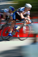 Male athletes competing in a bike criterion race in North Boulder Park in Boulder, Colorado