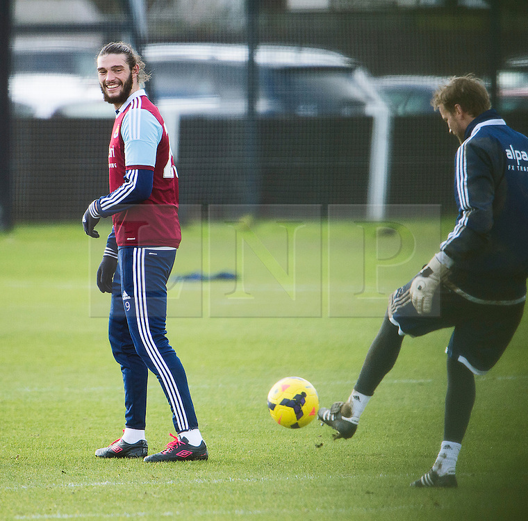 © London News Pictures. 28/01/2014. London, UK. Striker ANDY CARROLL (left) during West Ham United training at their training ground in Chadwell Heath, East London ahead of their premiership game away to Chelsea on tomorrow night (29/01/2014). Photo credit: Ben Cawthra/LNP