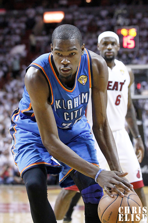 19 June 2012: Oklahoma City Thunder small forward Kevin Durant (35) almost lost the ball during the first quarter of Game 4 of the 2012 NBA Finals, Thunder at Heat, at the AmericanAirlinesArena, Miami, Florida, USA.
