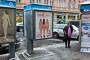 An adult-themed mens' cabaret entertainment ad on the side of an O2 phone kiosk, on 17th March, 2018, on Vodickova Street, in Prague, the Czech Republic.