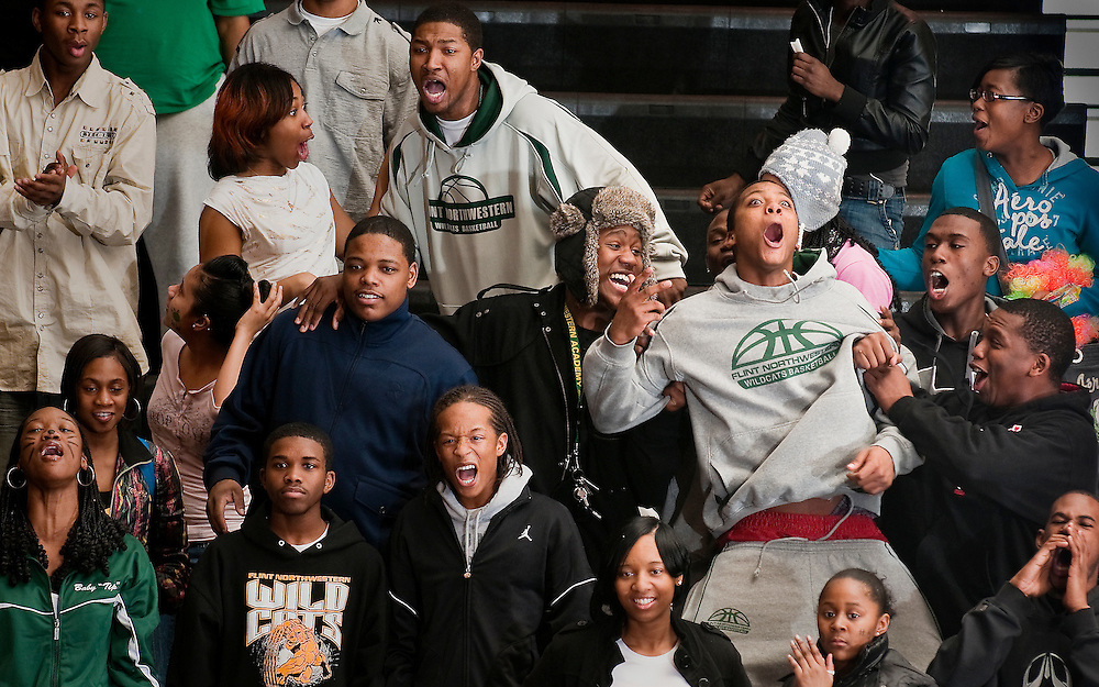 Matt Dixon | The Flint Journal..Flint Northwestern fans cheer on their team during a regional tournament game against Clarkston at Fenton High School, Tuesday, March 8. Northwestern lost 41-45 after one period of overtime.