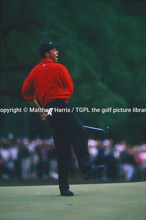 The moment when modern golf, as we know it, changed as a new superstar of golf is born: Tiger WOODS (USA) celebrates making a birdie 3 at the 18th par 4 to win by a staggering 12 shots from Tom KITE (USA) and win his first major during fourth round US Masters 1997,Augusta National,Augusta,Georgia,USA.