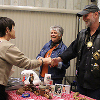 Nancy Camp visits with hobos Dutch Van Dammer and Gypsy Moon during the April 9 Lunching with Books program at the Amory Municipal Library.