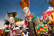 """Phi Ta Khon Festival, Dan Sai, Thailand.....The Phi Ta Khon or Ghost Festival is held each year combining the celebration of Boon Phra Wate held during the 4th lunar month and Boon Bung Fai held during the 6th lunar month.  It is a combination of Buddhist merit making and offerings to the spirits for rain and a productive rice harvest.  There are solemn ceremonies following normal Buddhist scripts and ghosts or spirits are often intertwined with this.....However, each year the 3 day festival draws raucous teams of local mask makers, mostly young men, who dress as Phi Ta Khon """"Ghosts"""" and consume large quantities of lao khao (rice wine).  The Phi Ta Khon parade through the streets with large wooden phallus symbols playfully teasing everyone.  Each day the parade ends at Phon Chai Temple where the Phi Ta Khon and the town's people circle the temple repeatedly dancing and cheering.  There are also giant Phi Ta Khon Yai made of bamboo resembling men and women with exaggerated genitals.  Many in the crowd take turns leading the male Phi Ta Khon Yai around the temple by his sex organ.  ....The top of the masks are made of traditional rice baskets and rockets are fired into the sky to please the spirits and signal for rain.....The parade celebrates the Buddha's last great incarnation before achieving enlightenment.  According to legend the last incarnation was celebrated with such fervor that the parade invoked the spirits to join in the festivities..."""