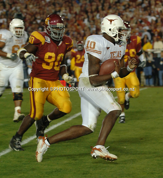 January 4, 2006; Texas Longhorns quarterback Vince Young finds a hole to run through and then scores a touchdown during the USC Trojans game versus Texas Longhorns in the Rose bowl game and BCS National Championship at the Rose Bowl in Pasadena, CA, USA on January 4, 2006. Texas defeated USC 41 to 38. Photo: Icon SMI/PHOTOSPORT<br />