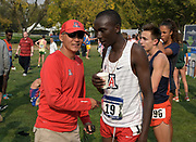 Nov 9, 2018; Sacramento, CA, USA; Arizona Wildcats coach  James Li talks with Shem Kemboi (19) during the NCAA West Regional at Haggin Oaks Golf Course.
