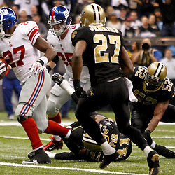 November 28, 2011; New Orleans, LA, USA; New York Giants running back Brandon Jacobs (27) runs for a touchdown against the New Orleans Saints during the third quarter of a game at the Mercedes-Benz Superdome. Mandatory Credit: Derick E. Hingle-US PRESSWIRE
