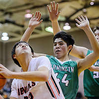 Gallup Bengal Colton Lowley (32) press back against Farmington Scorpion Kody Becenti (44) Friday at Gallup High School.