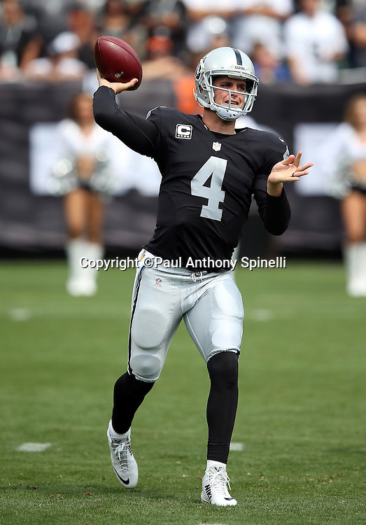 Oakland Raiders quarterback Derek Carr (4) throws a first quarter pass during the 2015 NFL week 1 regular season football game against the Cincinnati Bengals on Sunday, Sept. 13, 2015 in Oakland, Calif. The Bengals won the game 33-13. (©Paul Anthony Spinelli)